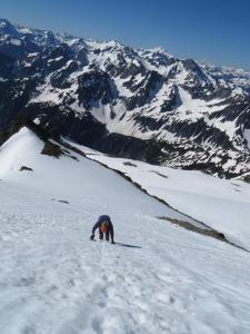 Downclimbing steep slope under  Sahale Peak