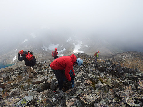 Group of mountaineers preparing for descend