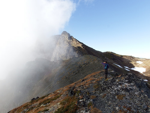 Scree filled slope leading to yet another false summit