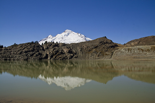 Mount Baker reflecting in largest of the tarns on the plateau.