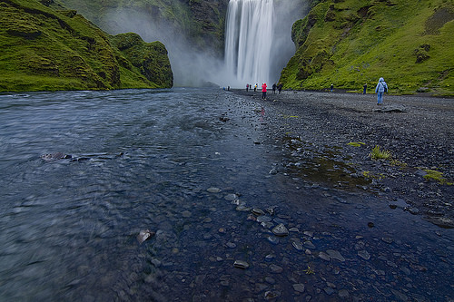 Hundreds of people come to admire Skogafoss, no matter what the weather.